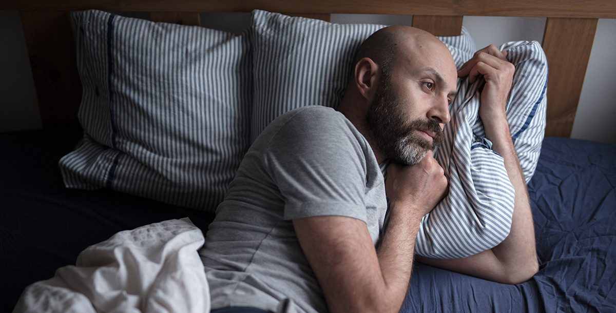 A man having trouble sleeping at night.