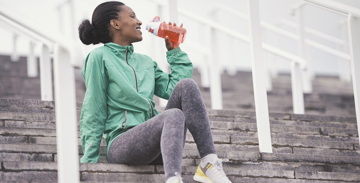 A woman rehydrating after her race.