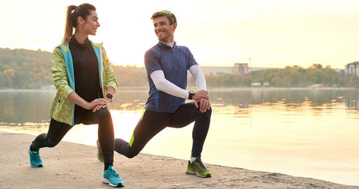 Two people stretching before a run.