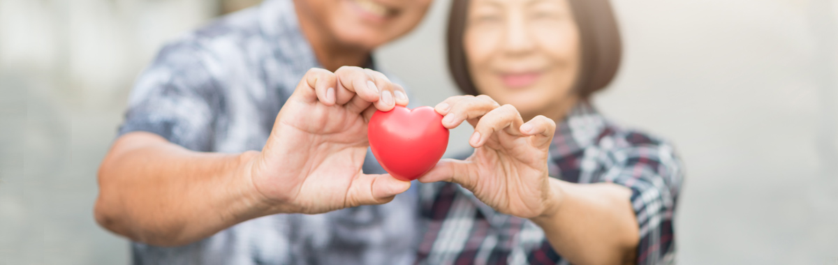 man and woman holding a heart - TAVR