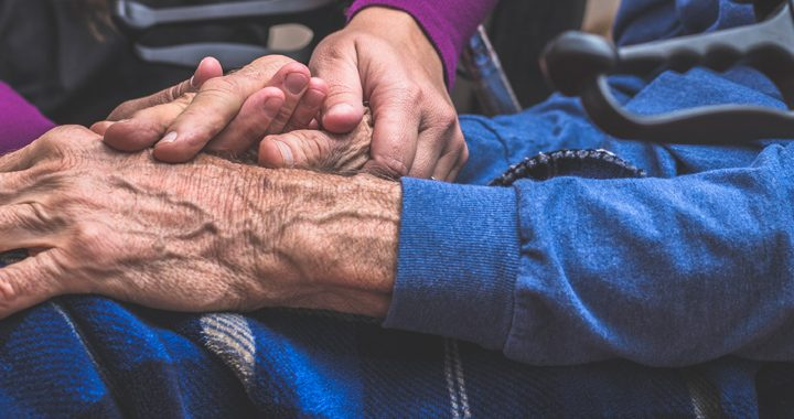 man and woman hold hands _ parkinsons disease