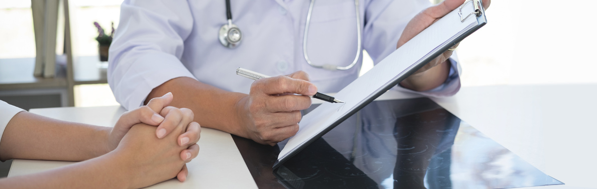 doctor shows patient test results_ why not to skip your annual primary care visit