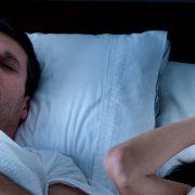 man sleeping with mouth open - sleep apnea