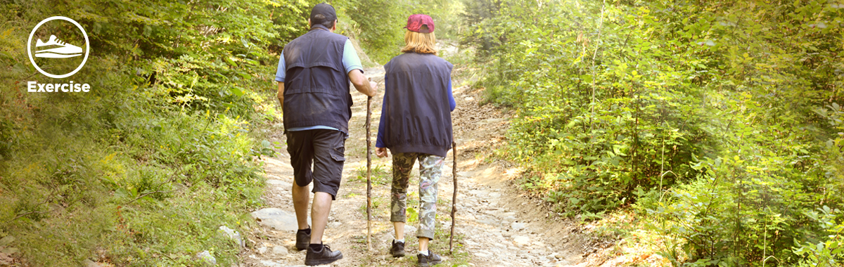 man and woman hike in nature _ benefits of walking