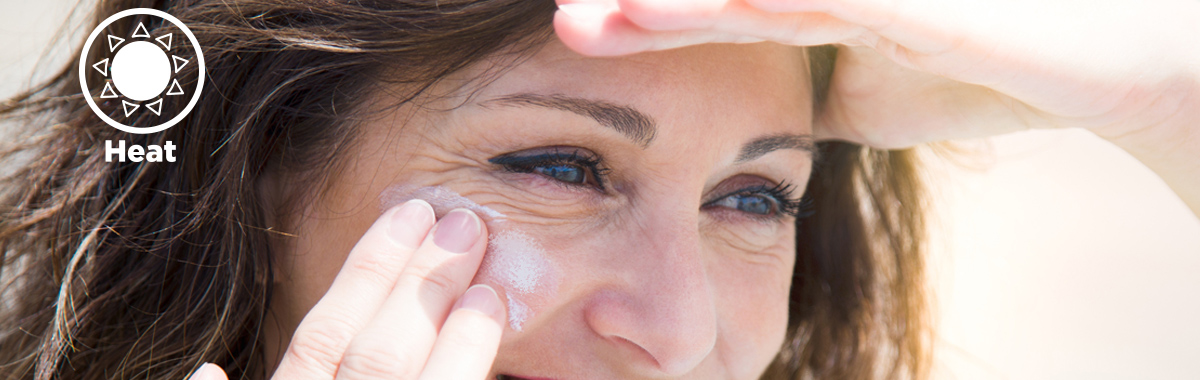 woman applies sunscreen _ what spf level is needed