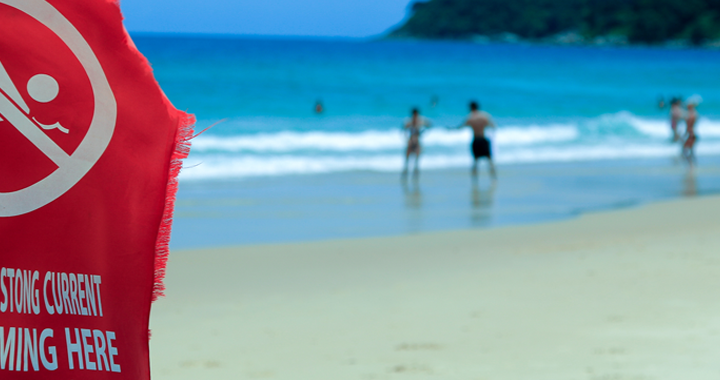 safety flag on a beach _ safety tips for different destination types