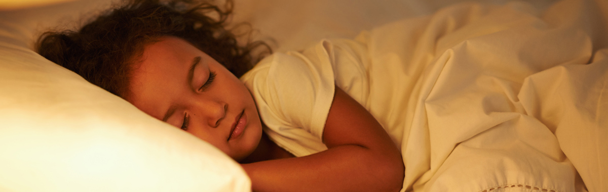 child sleeps on pillow _ adjusting your kids schedules for back to school