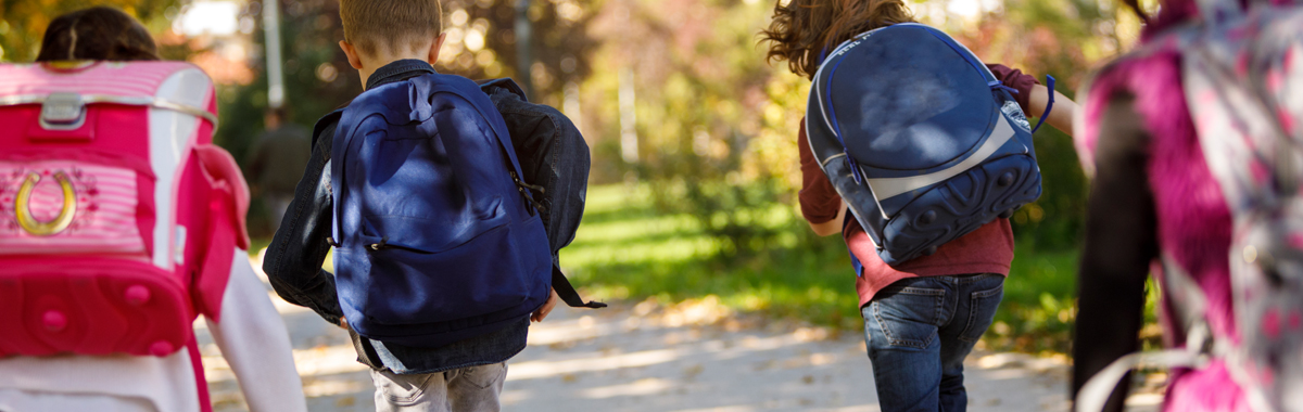 two kids walk with their backpacks _ backpack health tips mercy health