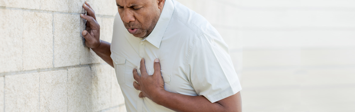 man touches his chest because of chest pain _ surviving a heart attack blog from mercy health