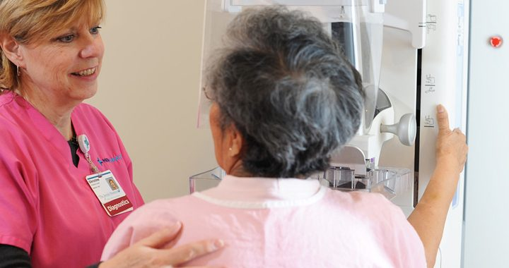 patient and health care worker talking during mammogram