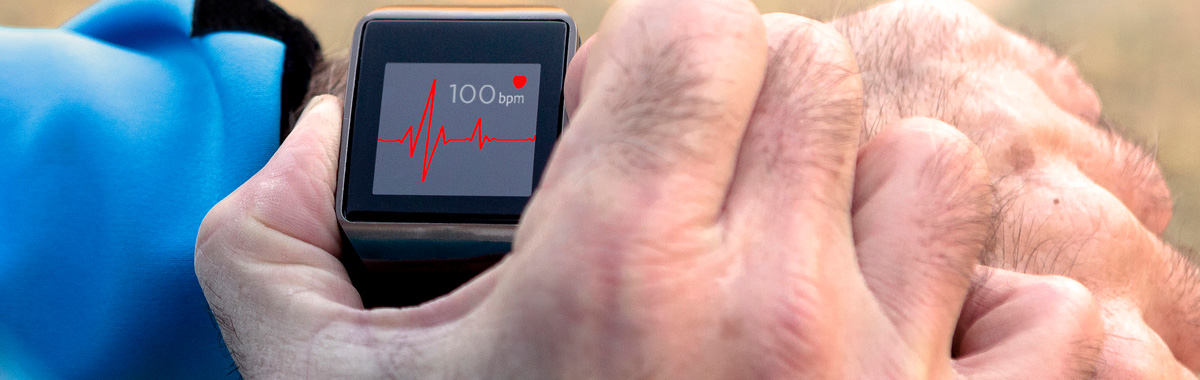 Close-up of man's hand using Apple watch to perform EKG - Atrial Fibrillation, Afib