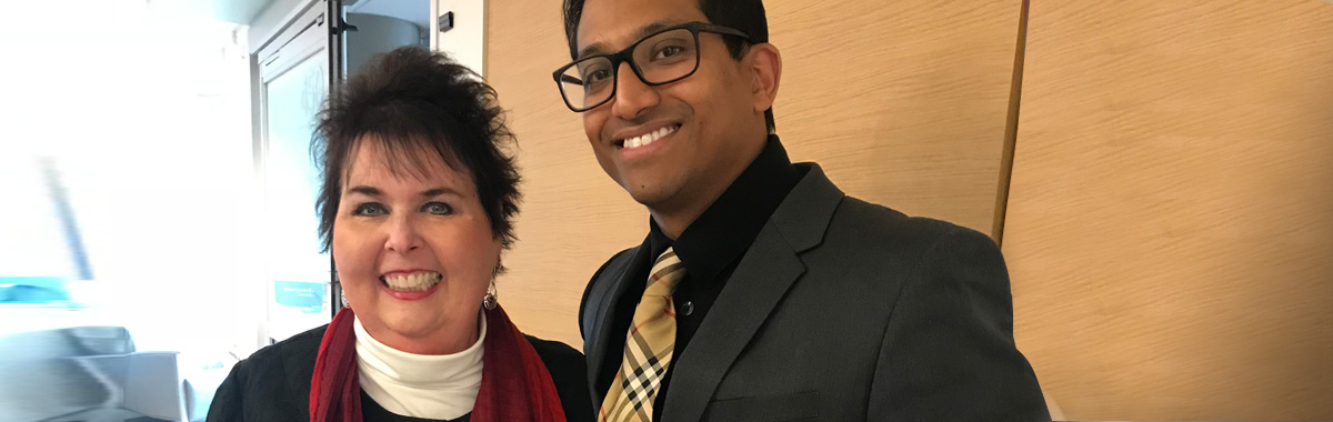 Patient Connie Davidson, treated at Mercy Health - West Hospital for flesh-eating bacteria, standing next to treating physician Dr. Neil Kundu