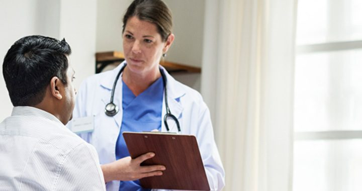 men's health female doctor consults with male patient