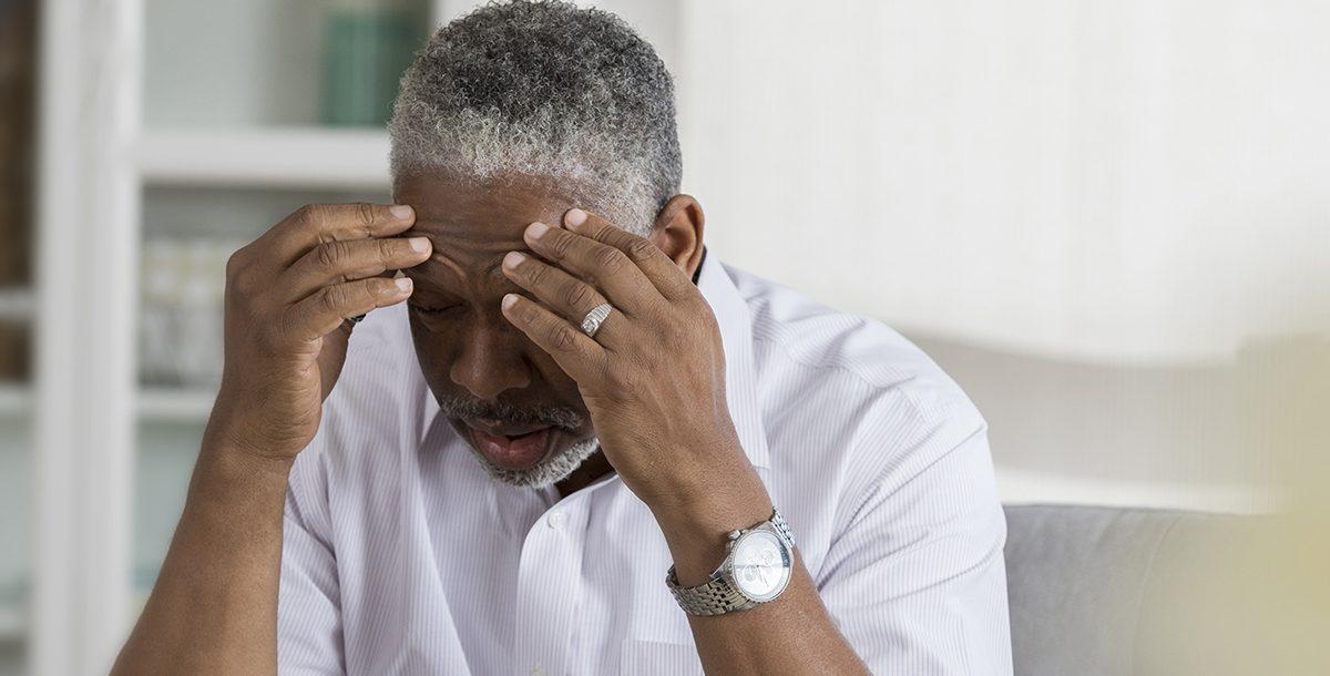 An older man experiencing vertigo
