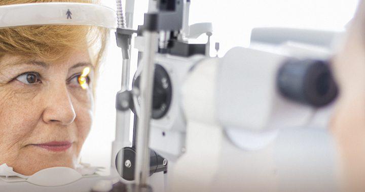Woman having eye health checked by getting eye exam