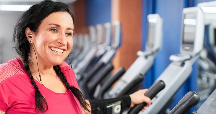 Woman named BobbiJo smiling while on treadmill after weight loss surgery