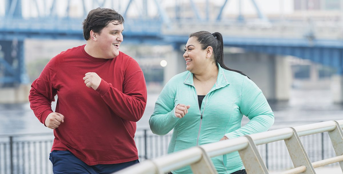 Two people staying active to boost their metabolism.