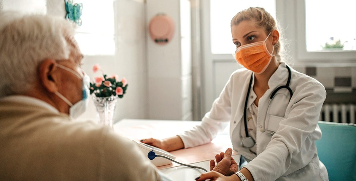 A patient meeting with their primary care provider.