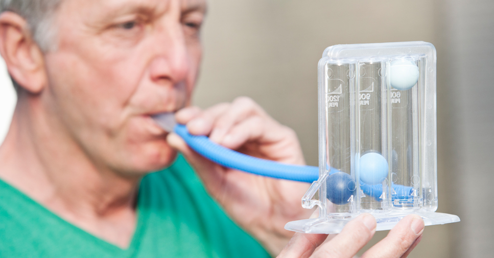 gentleman undergoing spirometry test for COPD