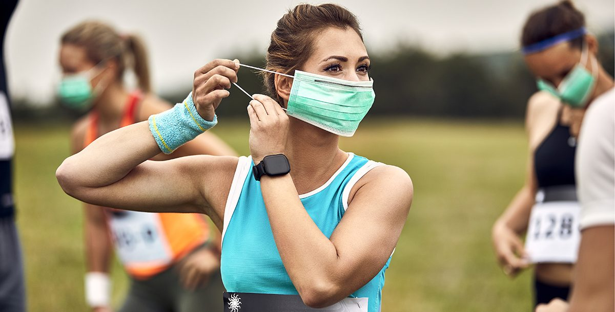 A woman getting ready to run.