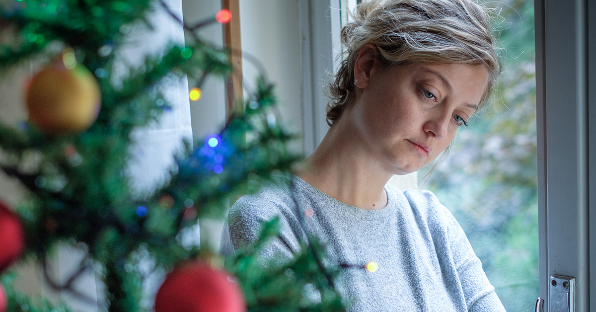 A woman grieving during the holidays
