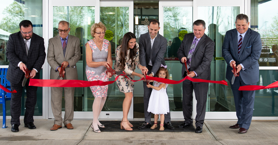 The Bitar family and other staff cut a red ribbon to open the doors of the Bitar Medical Center