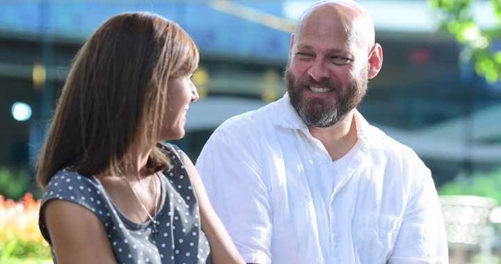 Ray Wenes, who survived living with a brain tumor, looks at his wife and smiles