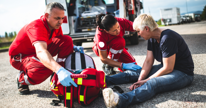 EMS team responds to a medical emergency outside in a parking lot