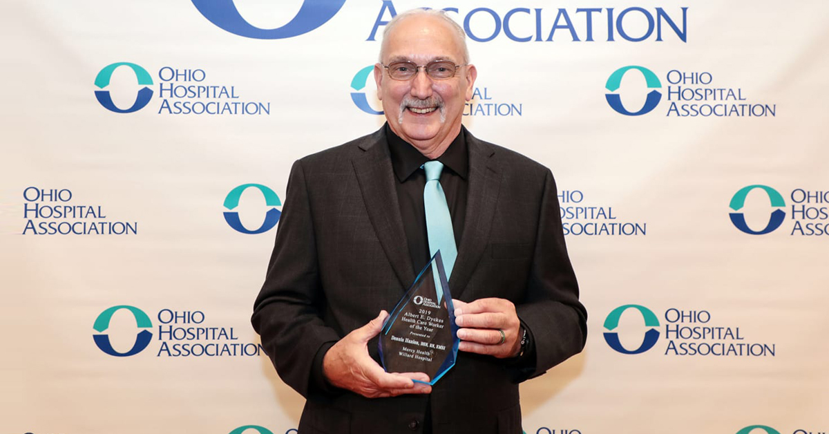 Dennis Hanlon, BSN, RN, EMSI, Paramedic, a shift supervisor in nursing administration at Mercy Health – Willard Hospital, holds his award for being the OHA Health Care Worker of the Year