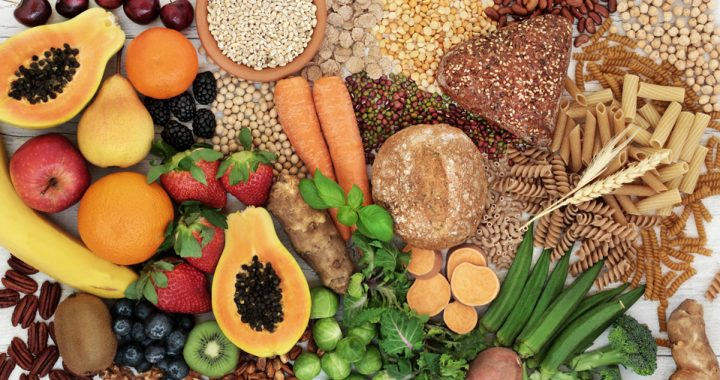 A colorful spread of fruits, vegetables and various grain products contain insoluble and soluble fiber