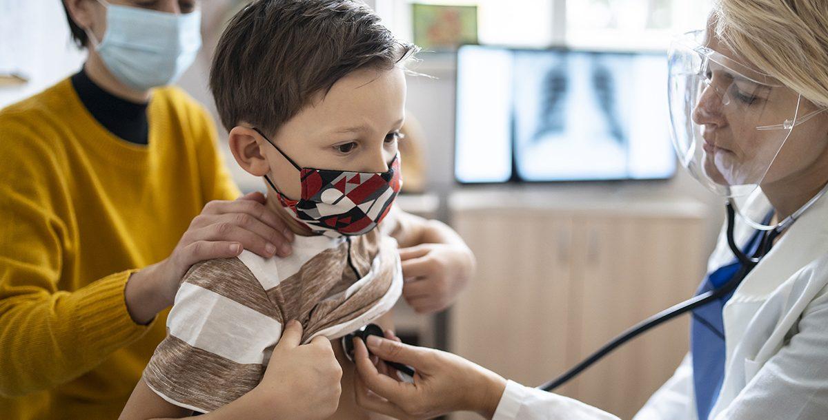 A child having their annual physical with their pediatrician