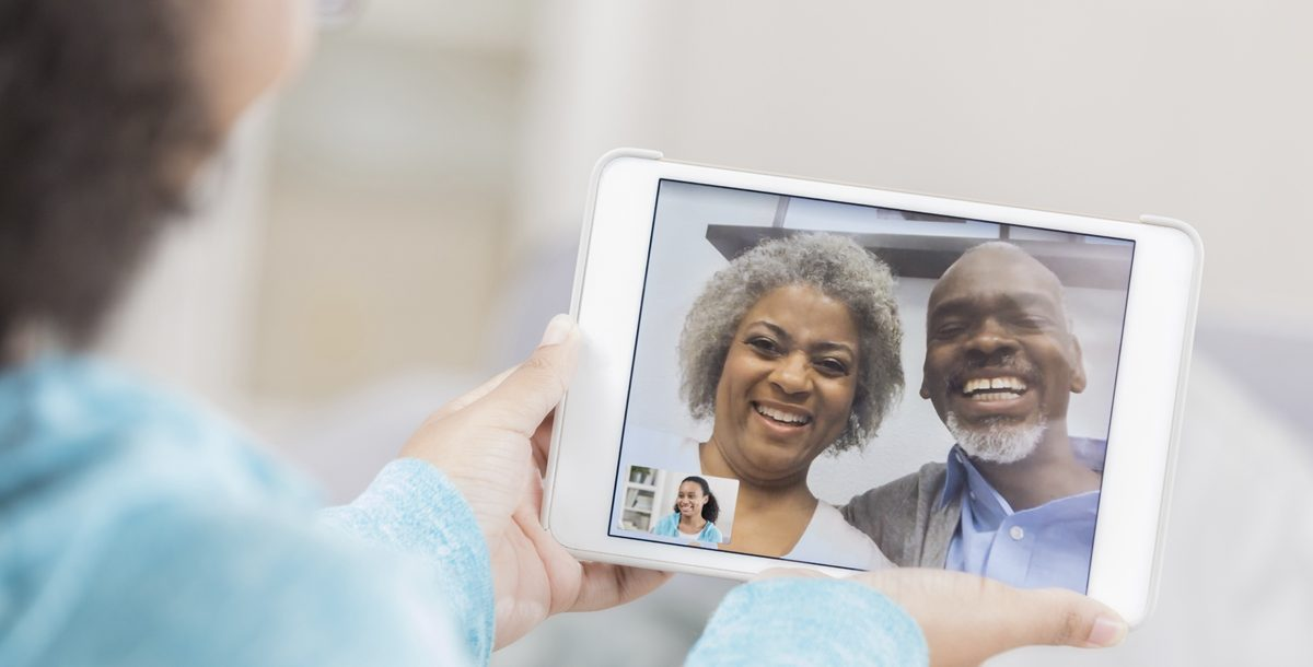 Grandchild video chatting with grandparents during social distancing