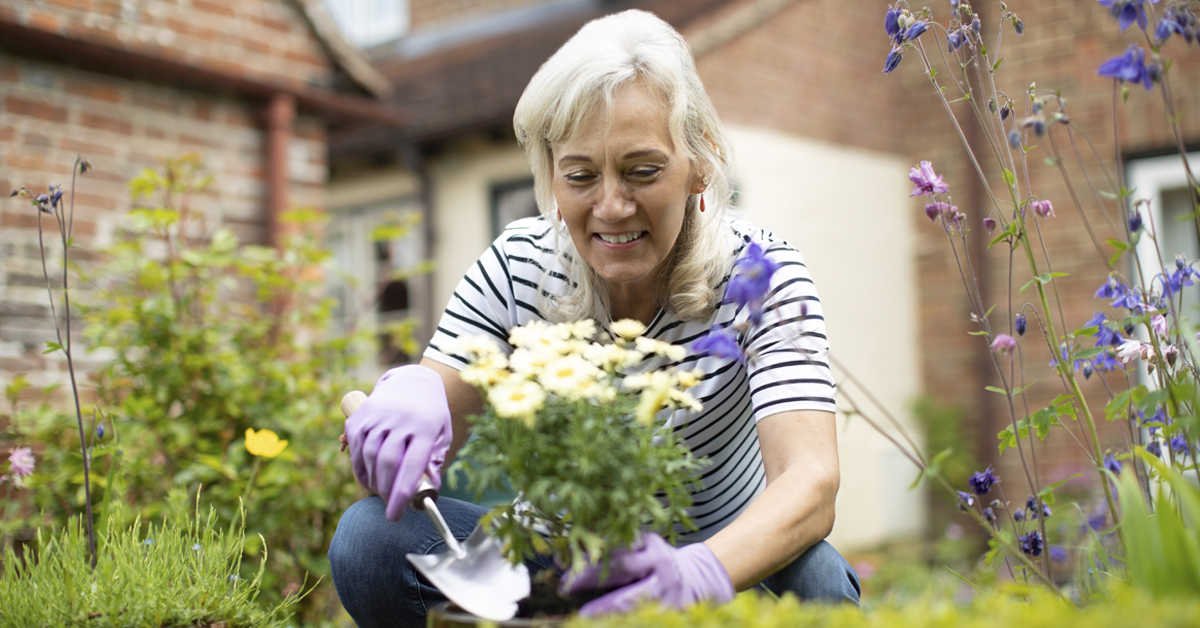 Women practicing social distancing by gardening at home.