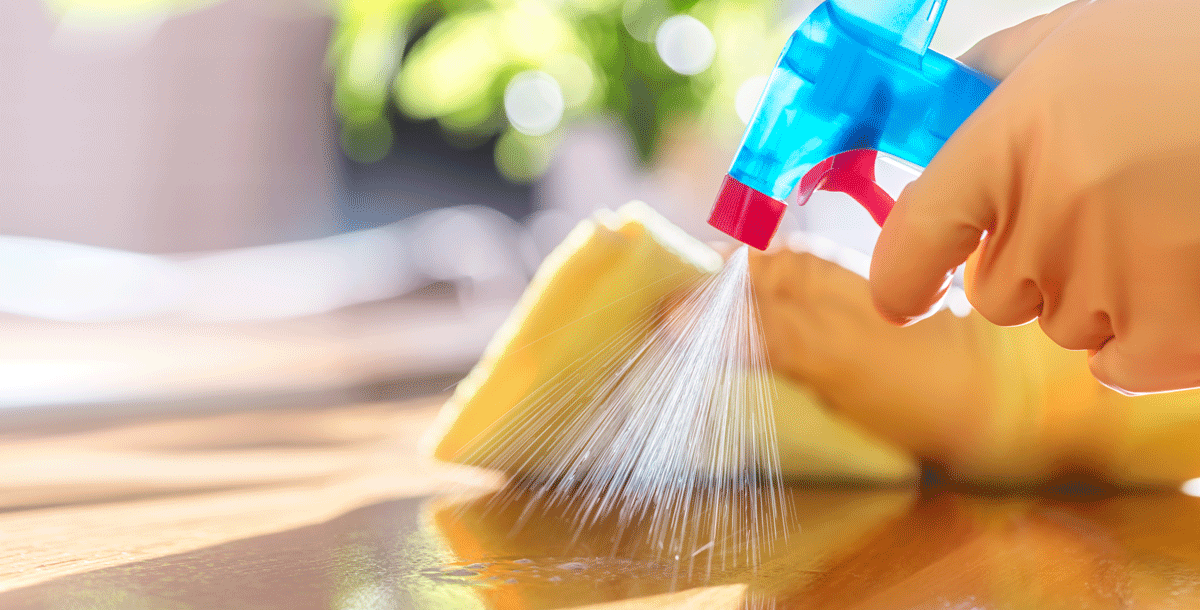 A person cleaning and disinfecting a household surfaces during COVID-19.