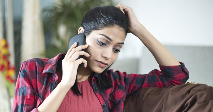 Woman advocating for a loved one by staying in touch with hospital staff via phone