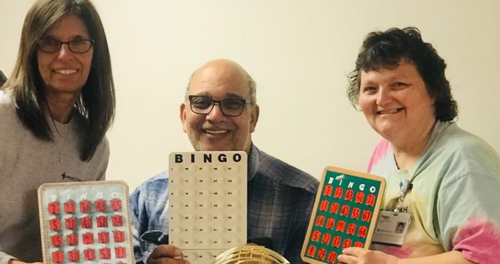Tonya West with coworkers playing hallway bingo during COVID-19.