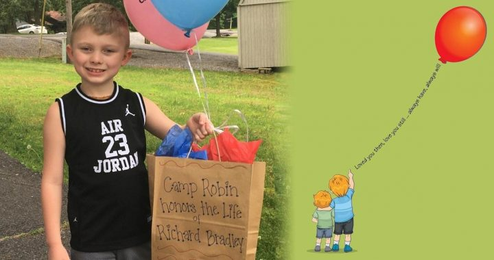 A child receiving his Camp Robin personalized care package.