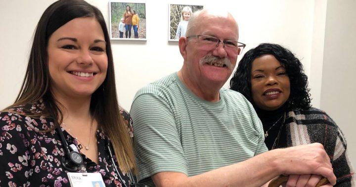 Michael Braun with Mercy Health staff members.