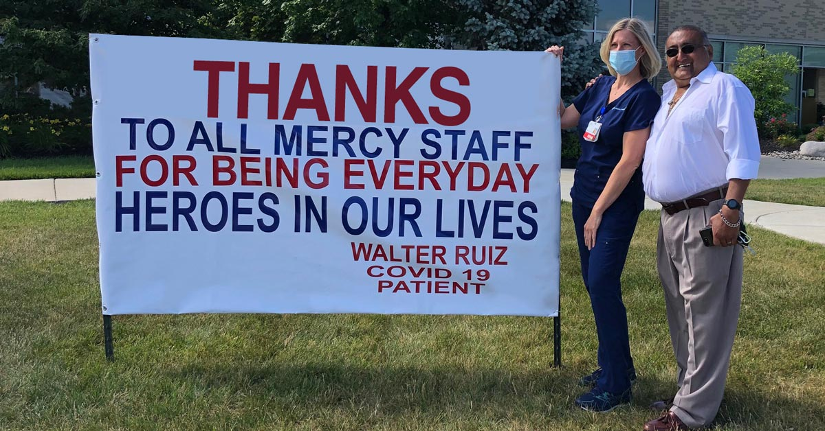Walter Ruiz and Lisa Lane outside Fairfield Hospital by his sign.