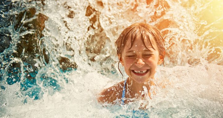 Girl swimming in water during the summer