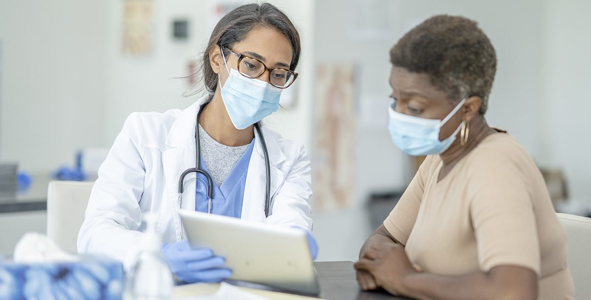 A patient discussing health screenings results with their primary care provider.