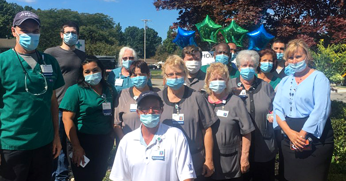 Tom Hoerlle with his team members at Lorain Hospital.