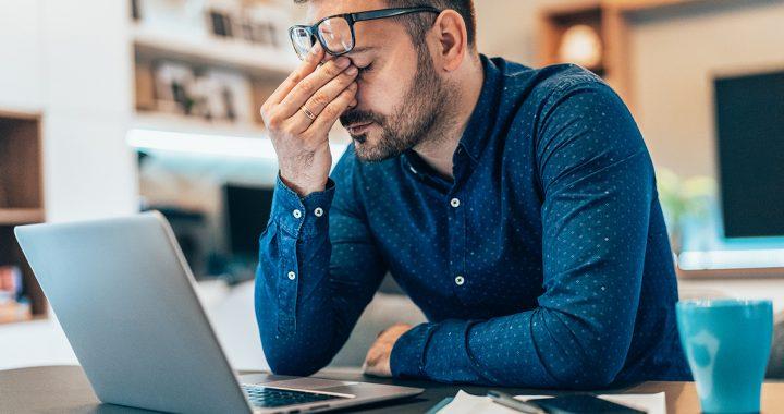 A man experiencing symptoms of burnout.