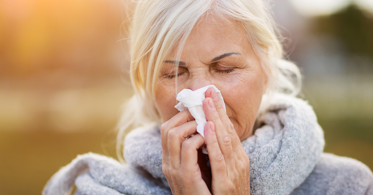 A woman experiencing fall allergies.