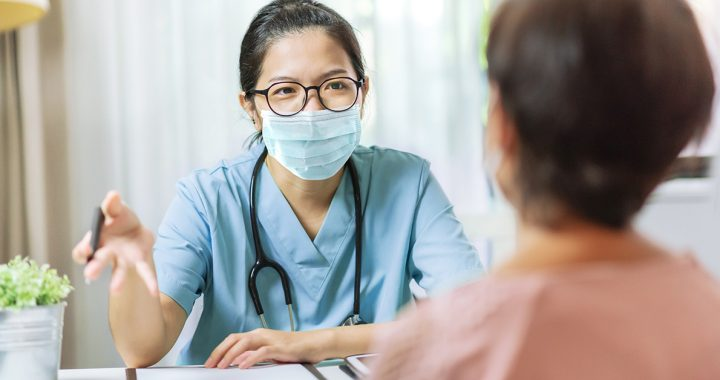 A health care professional meeting with a patient.