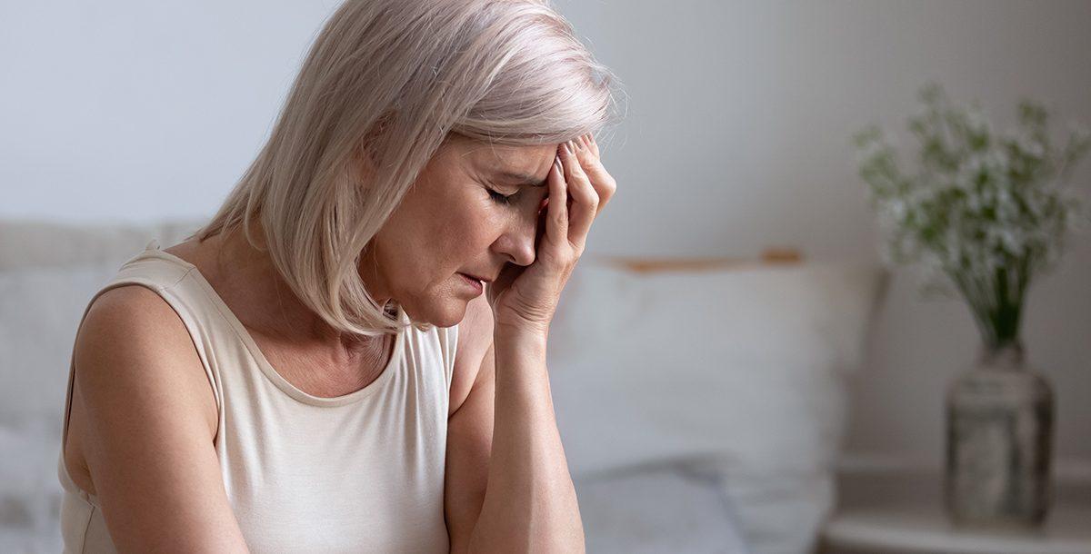An older adult experiencing flu symptoms.