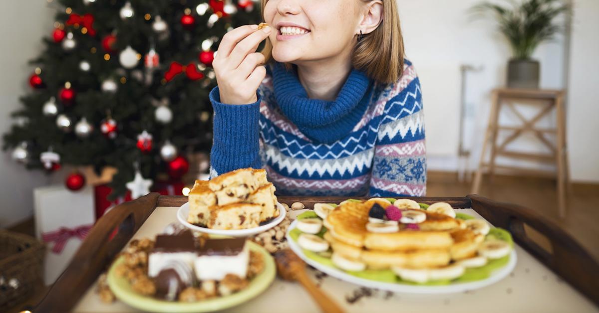 A woman enjoying holiday treats.