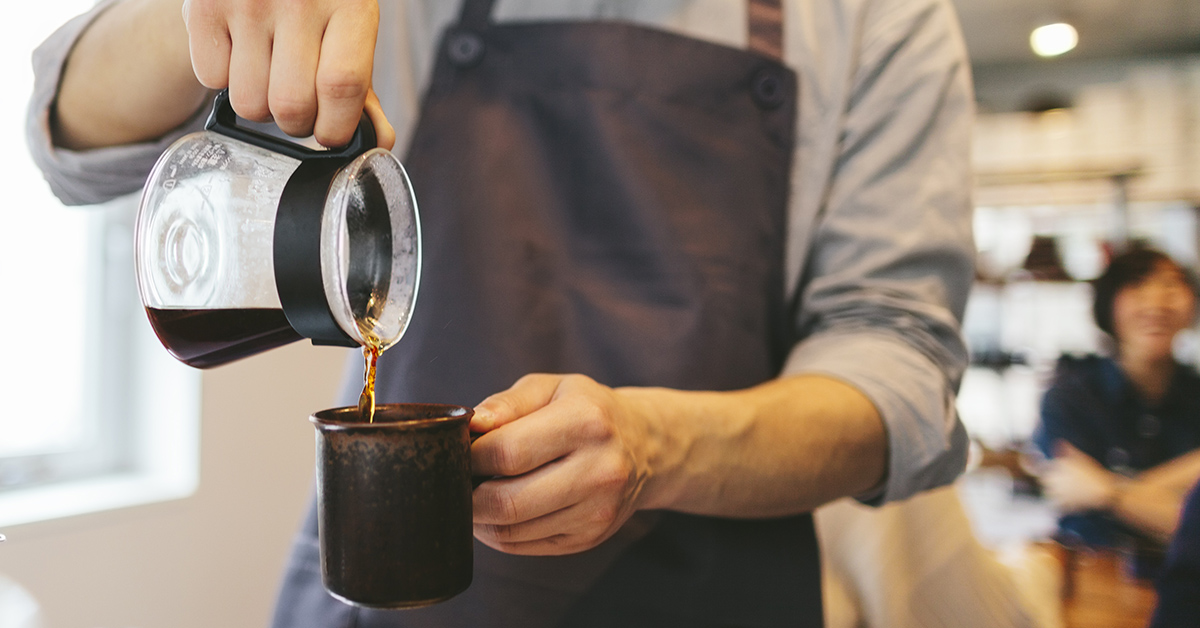 A man pouring coffee.