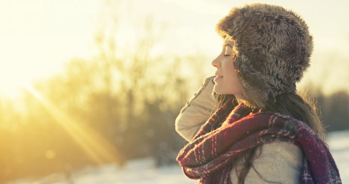 A person enjoying sunshine during the winter.