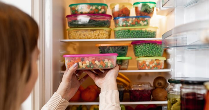 A woman meal prepping in her kitchen.,